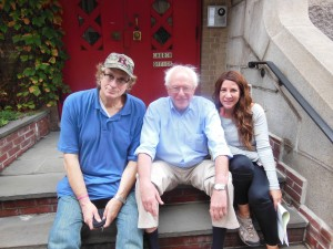 at Peoples Climate March sitting on a stoop with Senator Bernie Sanders of Vermont & Mia Hathoway
