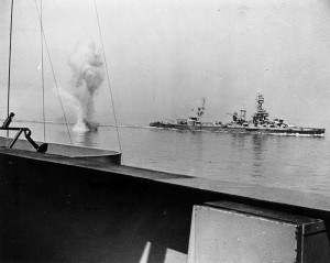 A heavy German coast artillery shell falls between USS Texas and USS Arkansas while the two battleships engage the German battery in Battle of Cherbourg just as William described.
