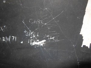 Steel Mill 1971 scrawled on the mens bathroom wall.