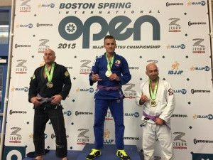 Cozmo winning medal at Boston Championship