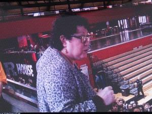 On the big scoreboard screen